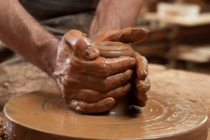 Molding the clay on the Potter's Wheel